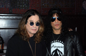 01/10/2011 - Ozzy Osbourne, Slash - Ozzy Osbourne and Slash Sign 10 Foot Guitar at House of Blues in Hollywood on January 10, 2011 - House of Blues - Hollywood, CA, USA - Keywords: Black suit, Gold Cross, Sun Glasses - False - Photo Credit: Travis Jourdain / PR Photos - Contact (1-866-551-7827)