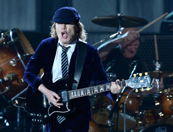 LOS ANGELES, CA - FEBRUARY 08:  Guitarist Angus Young of AC/DC performs onstage during The 57th Annual GRAMMY Awards at the at the STAPLES Center on February 8, 2015 in Los Angeles, California.  (Photo by Kevork Djansezian/Getty Images)