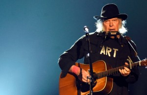 LOS ANGELES, CA - FEBRUARY 06:  Singer Neil Young performs onstage at the 25th anniversary MusiCares 2015 Person Of The Year Gala honoring Bob Dylan at the Los Angeles Convention Center on February 6, 2015 in Los Angeles, California. The annual benefit raises critical funds for MusiCares' Emergency Financial Assistance and Addiction Recovery programs.  (Photo by Frazer Harrison/Getty Images)