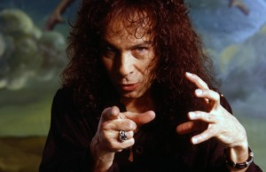 LOS ANGELES - APRIL 10: Singer Ronnie James Dio poses for a portrait in front of a painting by Manuel Ocampo on April 10, 1990 in Los Angeles, California. (Photo by Ann Summa/Getty Images)